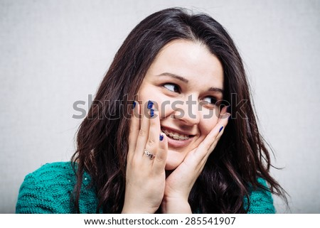 girl covers her face with her hands