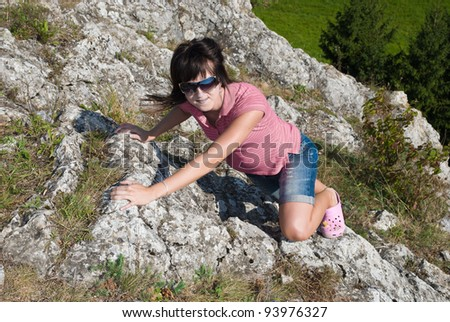 girl crawling in the mountains
