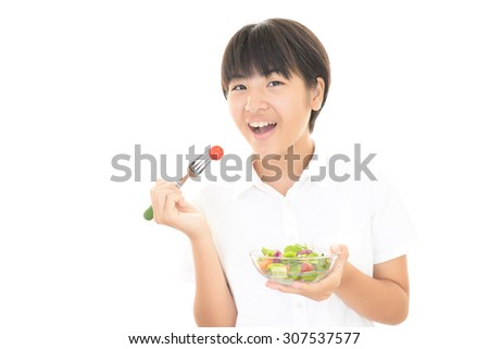 Girl eating a salad