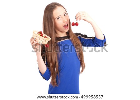 Girl eating cherries isolated on white background
