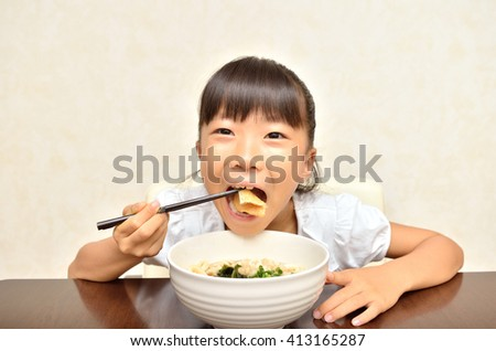 Girl eating delicious japanese noodles