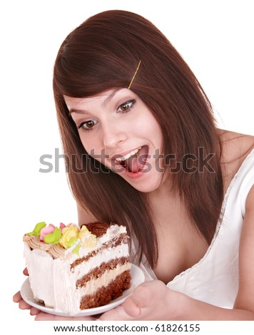 Girl eating piece of cake. Isolated.