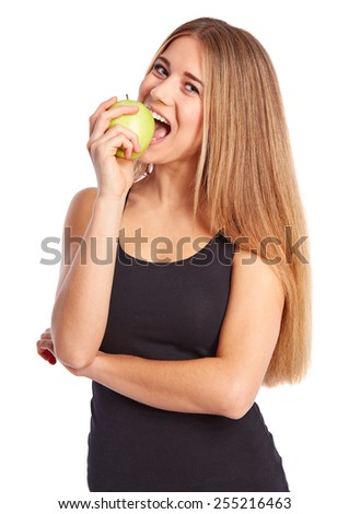 Girl eats a green apple on a white background