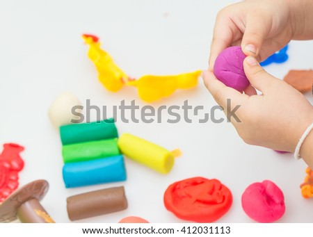 girl happy play dough  on white Background