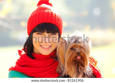 girl hold small dog in hands