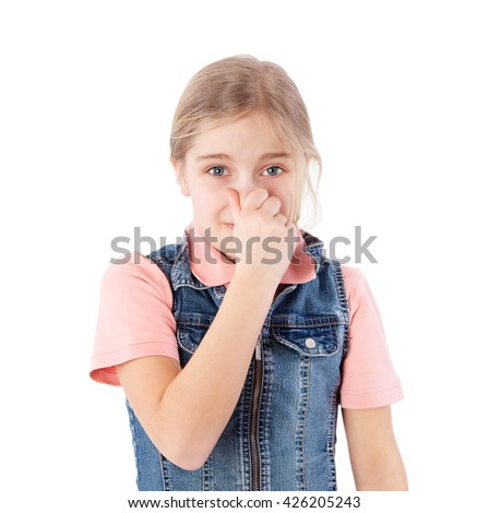 girl holding her nose because of a bad smell