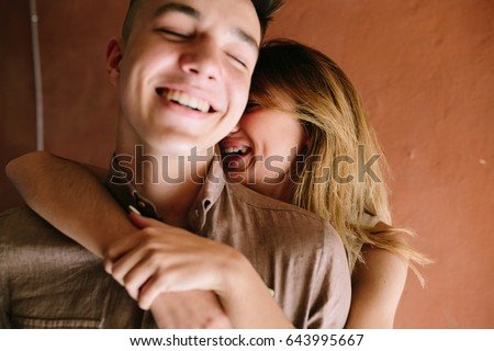 girl hugging guy from behind