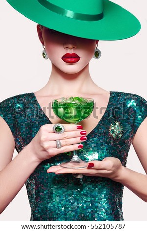 Girl in a green hat with a cocktail in hand. Green party dress ...