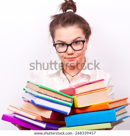 Girl in glasses holding a lot of books