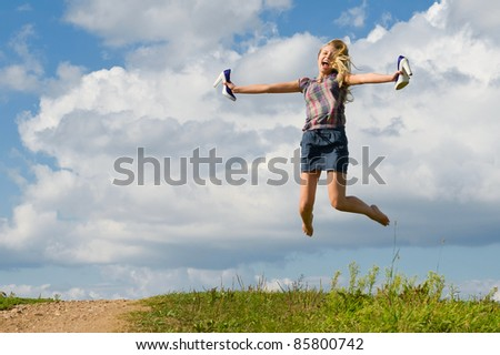Girl is jumping outdoors