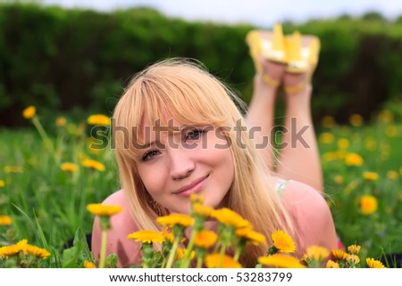girl is laying down on the grass