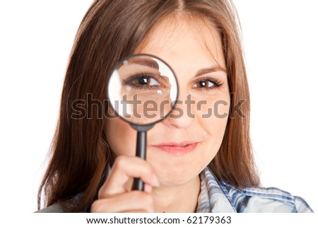 Girl is looking through magnifying glass. Isolated on white background