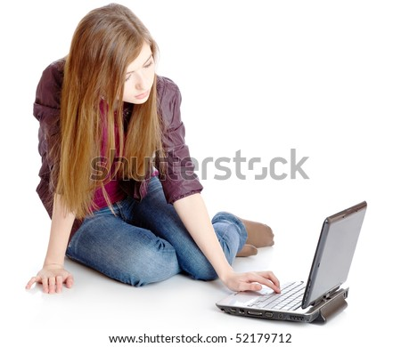 Girl is sitting on a floor with laptop. Isolated on white background
