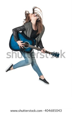 Girl jumping with a guitar
