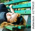 girl lying on the bench. retro portrait - stock photo