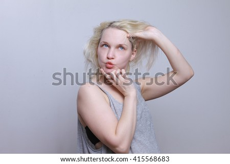 Girl makes faces. Crazy woman. Blonde