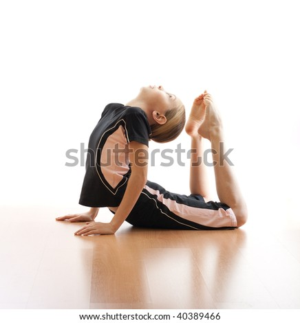 Girl making frog on floor in bodysuit