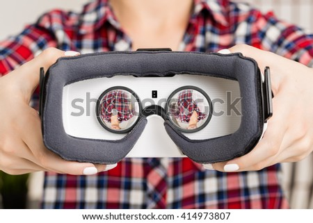 Girl offers to wear glasses virtual reality, VR goggles, VR-headset glasses
