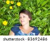 girl on dandelion on green field - stock photo