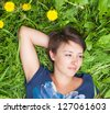 girl on dandelion on green spring field - stock photo