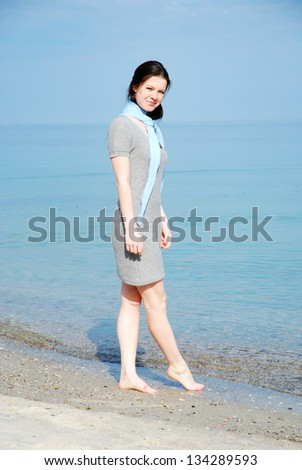 girl on the beach with blue shawl
