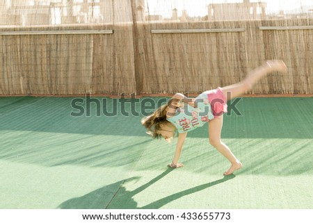 girl playing on the terrace on artificial turf