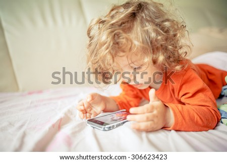 girl playing with a smartphone