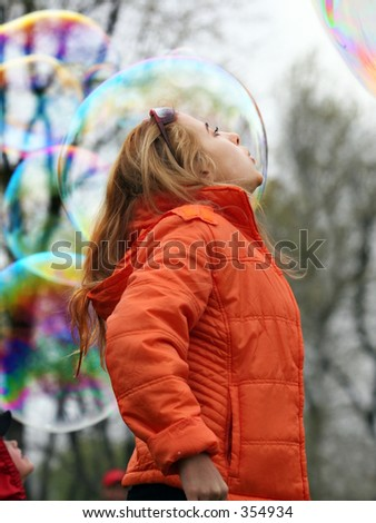 Girl playing with bubbles in a park