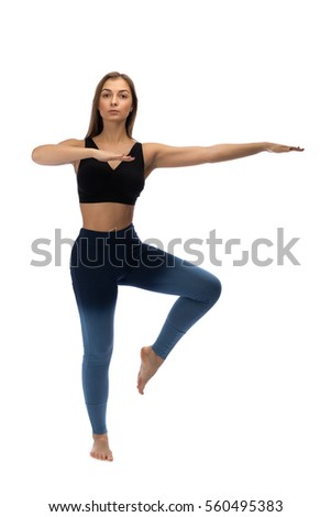 Girl practicing yoga in a studio on a white background. Isolated