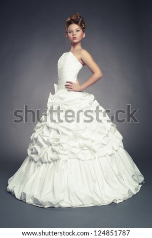 Girl princess in white ball gown on black background