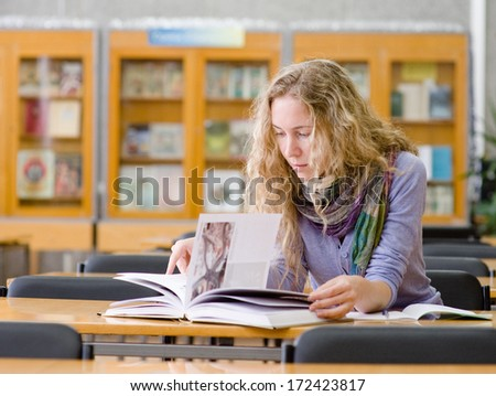 girl read book in library