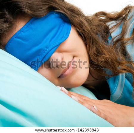 girl sleeping in a bandage for eyes