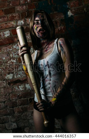 Girl stained paint with a baseball bat
