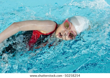 Girl swimming stroke closeup