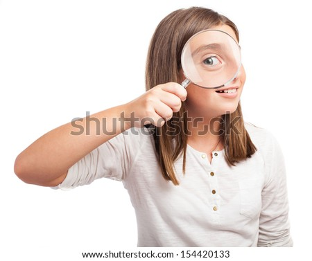 girl using a magnifying glasses on a white background