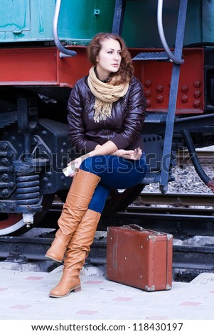 girl waiting for landing on the platform in the train