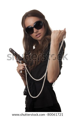 Girl with a necklace and a gun