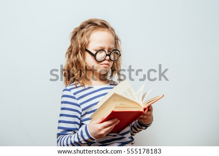 Girl with book.  smart appearance with glasses