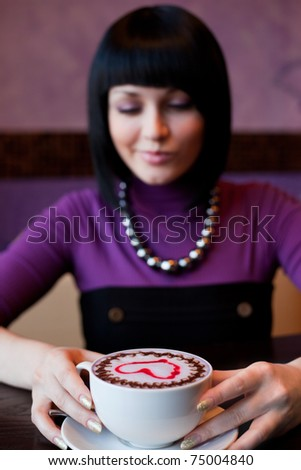 girl with cup of coffee, focus on coffee