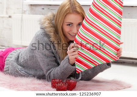 Girl with decoration paper preparing gifts
