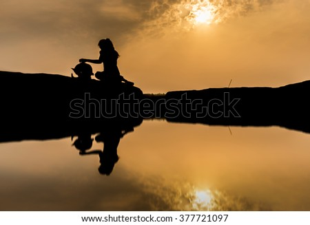Girl with dog, New friendship at sam pan bok, Ubon Ratchathani, Thailand whit water reflection.