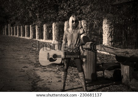 girl with guitar at road