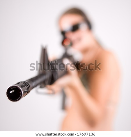 Girl with gun and glasses