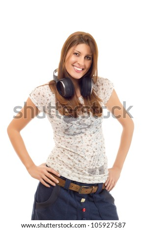 Girl with headphones - Attractive casually dressed female in her twenties wearing wireless headphones on her neck and smiling. Shot on white background.