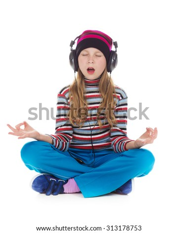 Girl with headphones listening to music on a white background.