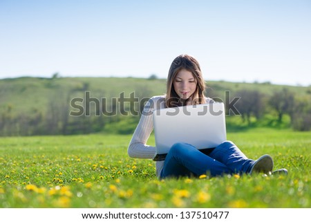 girl with laptop outdoors