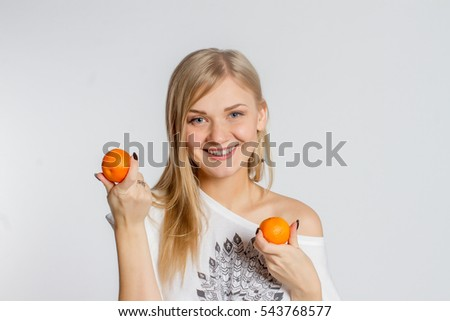 Girl with oranges on white background