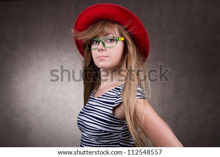 girl with red cap and eyeglasses