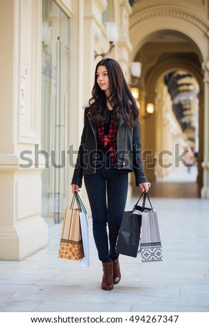Girl with shopping bags.Beautiful young girl came to the shopping in Moscow, Russia