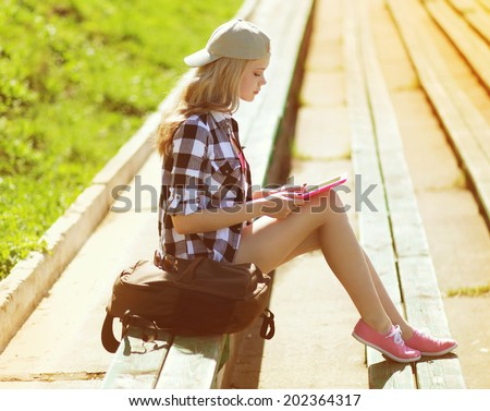 Girl with tablet pc working in the city park, student, education, modern youth - concept